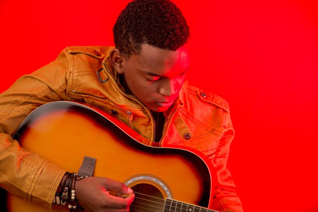 Joseph Rutakangwa playing guitar